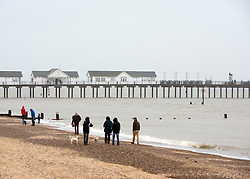 © Licensed to London News Pictures. 23/11/2014. Southwold, UK People walk along the promenade at Southwold, Suffolk, today 23 November 2014. The Met office has issued a yellow warning of rain for the area. Photo credit : Stephen Simpson/LNP