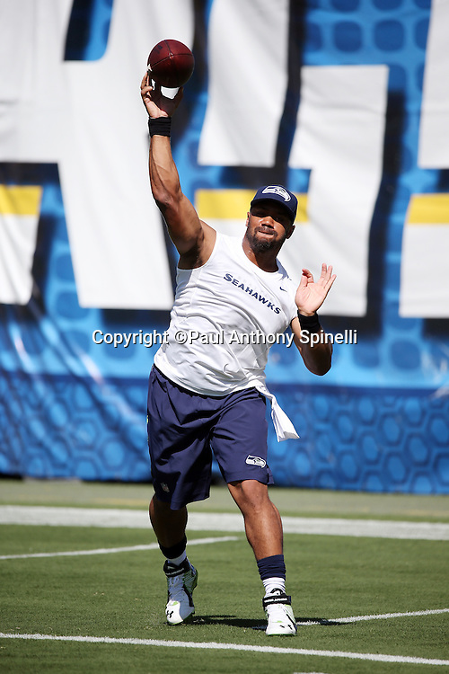 Seattle Seahawks quarterback Russell Wilson (3) throws a pass as he warms up in workout gear before the 2015 NFL preseason football game against the San Diego Chargers on Saturday, Aug. 29, 2015 in San Diego. The Seahawks won the game 16-15. (©Paul Anthony Spinelli)