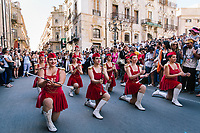 "PALERMO, ITALY - 16 JUNE 2018: Majorettes perform for Marinella Senatore's performance ""Palermo Procession"" at Manifesta 12, the European nomadic art biennal, in Palermo, Italy, on June 16th 2018.<br /> <br /> Manifesta is the European Nomadic Biennial, held in a different host city every two years. It is a major international art event, attracting visitors from all over the world. Manifesta was founded in Amsterdam in the early 1990s as a European biennial of contemporary art striving to enhance artistic and cultural exchanges after the end of Cold War. In the next decade, Manifesta will focus on evolving from an art exhibition into an interdisciplinary platform for social change, introducing holistic urban research and legacy-oriented programming as the core of its model.<br /> Manifesta is still run by its original founder, Dutch historian Hedwig Fijen, and managed by a permanent team of international specialists.<br /> <br /> The City of Palermo was important for Manifesta's selection board for its representation of two important themes that identify contemporary Europe: migration and climate change and how these issues impact our cities."