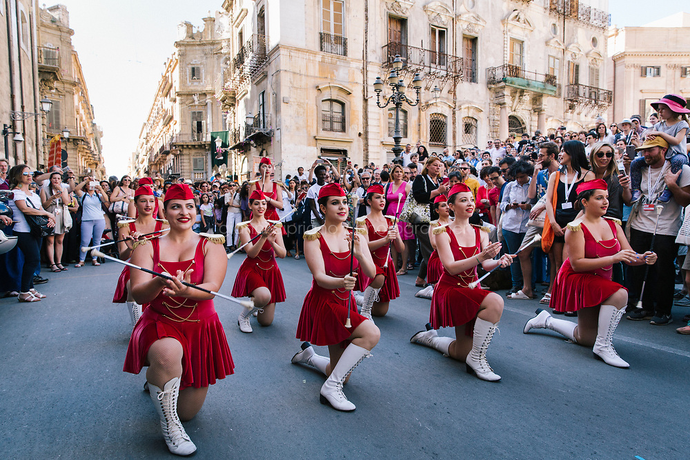 PALERMO, ITALY - 16 JUNE 2018: Majorettes perform for Marinella Senatore's performance &quot;Palermo Procession&quot; at Manifesta 12, the European nomadic art biennal, in Palermo, Italy, on June 16th 2018.<br /> <br /> Manifesta is the European Nomadic Biennial, held in a different host city every two years. It is a major international art event, attracting visitors from all over the world. Manifesta was founded in Amsterdam in the early 1990s as a European biennial of contemporary art striving to enhance artistic and cultural exchanges after the end of Cold War. In the next decade, Manifesta will focus on evolving from an art exhibition into an interdisciplinary platform for social change, introducing holistic urban research and legacy-oriented programming as the core of its model.<br /> Manifesta is still run by its original founder, Dutch historian Hedwig Fijen, and managed by a permanent team of international specialists.<br /> <br /> The City of Palermo was important for Manifesta&rsquo;s selection board for its representation of two important themes that identify contemporary Europe: migration and climate change and how these issues impact our cities.