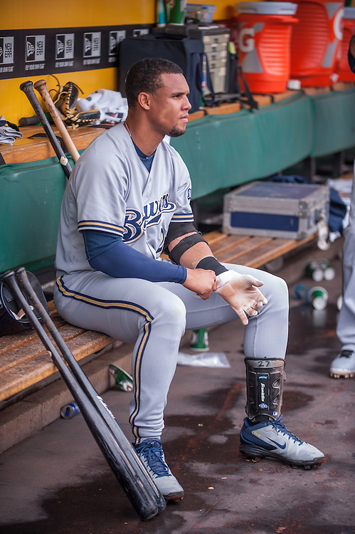 PITTSBURGH, PA - JUNE 08: Carlos Gomez #27  of the Milwaukee Brewers looks on in the dugout during the game against the Pittsburgh Pirates  at PNC Park on June 8, 2014 in Pittsburgh, Pennsylvania. (Photo by Rob Tringali) *** Local Caption *** Carlos Gomez