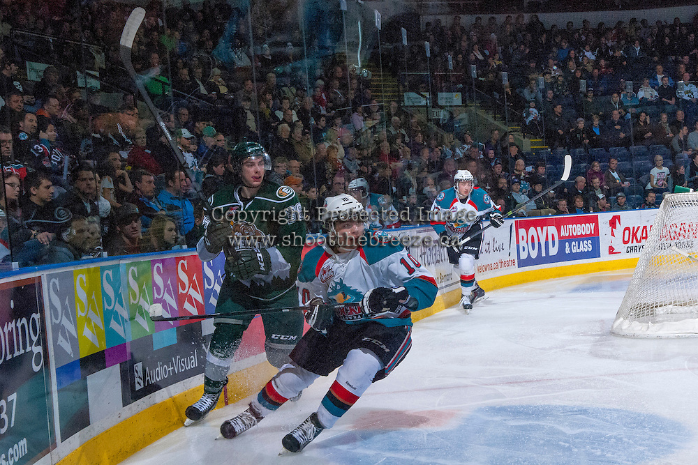 KELOWNA, CANADA - JANUARY 22: Nick Merkley #10 of the Kelowna Rockets checks Kevin Davis #38 of the Everett Silvertips during the second period on January 22, 2014 at Prospera Place in Kelowna, British Columbia, Canada.   (Photo by Marissa Baecker/Getty Images)  *** Local Caption *** Nick Merkley; Kevin Davis;
