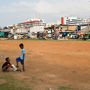 Children playing soccer at kampung Bandan, north Jakarta. <br />