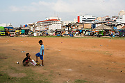 Children playing soccer at kampung Bandan, north Jakarta. <br /> <br /> With a population of more than 10 million people Jakarta is the largest city of Indonesia. During the periode of the Dutch East Indies Jakarta was known as Batavia. Since it became independent in 1949 Jakarta officially became the capital city of the Republic of Indonesia.  The economic heart of Southeast Asia attracts many people creating a vibrant diversity of cultures and people living in one of the busiest cities in the world. Inequality and poverty are one of Jakarta's challenges.