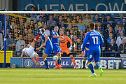 AFC Wimbledon Defender, Paul Robinson (6) kick a kick to the head from Portsmouth Defender, Christian Burgess (6) during the EFL Sky Bet League 1 match between AFC Wimbledon and Portsmouth at the Cherry Red Records Stadium, Kingston, England on 9 September 2017. Photo by Adam Rivers.