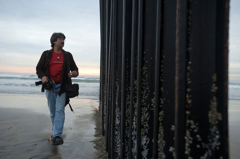 Tijuana Mexico ..photographer David Maung at the border fence in Playa Tijuana.<br /> Tijuana, Baja California, Mexico.<br /> <br /> &copy; Stefan Falke<br /> www.stefanfalke.com<br /> LA FRONTERA: Artists along the US Mexican Border