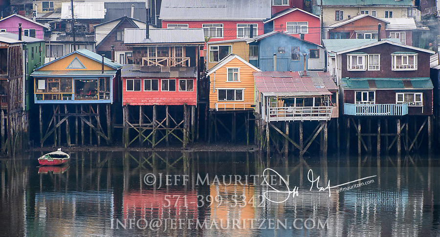 Coloful stilt houses known as palafitos in Castro, Chiloe Island, Chile.