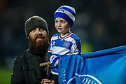 A young Queens Park Rangers fan and his father during  The FA Cup match between Queens Park Rangers and Sheffield Wednesday at the Kiyan Prince Foundation Stadium, London, England on 24 January 2020.