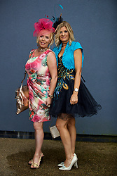 LIVERPOOL, ENGLAND - Thursday, April 6, 2017: Tracy Garner from Runcorn and her sister Paul Garner from Lymm. Tracy wearing a dress from Boo boo and Paula wearing a peacock dress from American Dress and a home-made fascinator, during The Opening Day on Day One of the Aintree Grand National Festival 2017 at Aintree Racecourse. (Pic by David Rawcliffe/Propaganda)