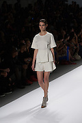 An off-white skirt with tunic top by Richard Chai at the Spring 2013 Mercedes Benz Fashion Week show in New York.