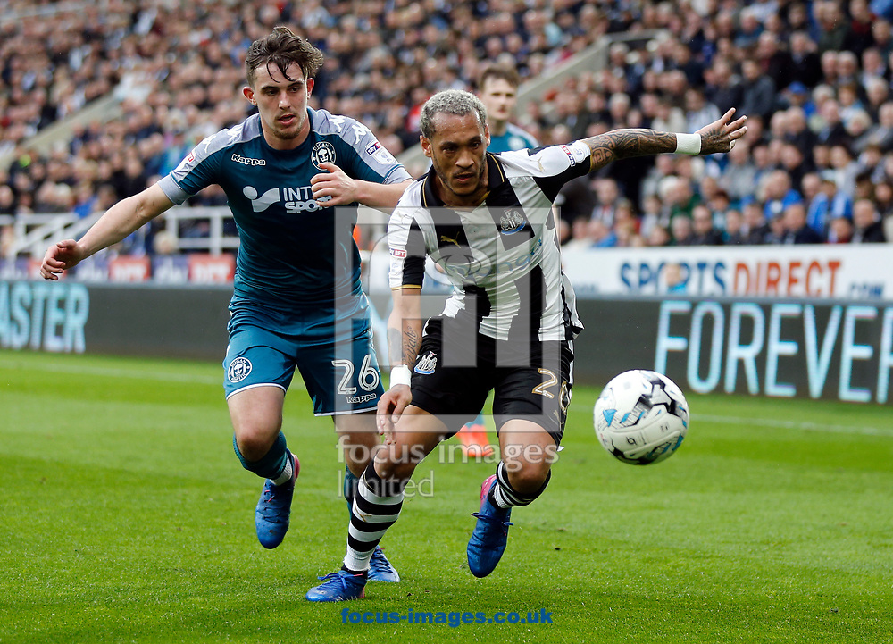Yoan Gouffran (r) of Newcastle United and Jamie Hanson of Wigan Athletic during the Sky Bet Championship match at St. James's Park, Newcastle<br /> Picture by Simon Moore/Focus Images Ltd 07807 671782<br /> 01/04/2017
