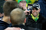 Norwich City forward Teemu Pukki (22) has a selfie with a Norwich fan after the EFL Sky Bet Championship match between Norwich City and Blackburn Rovers at Carrow Road, Norwich, England on 27 April 2019.