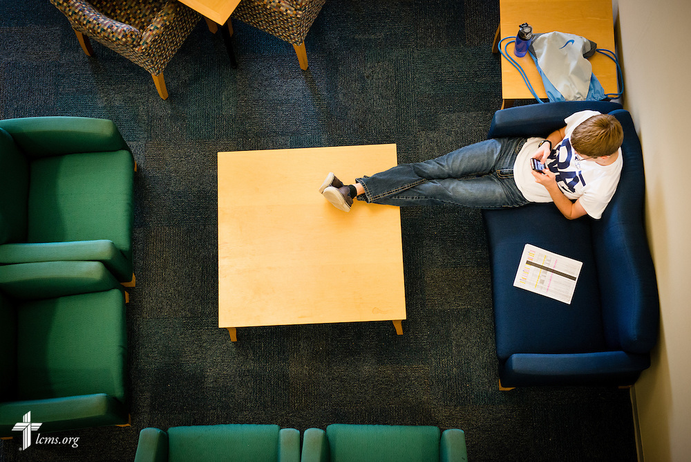 A young man relaxes in a common area Tuesday, July 29, 2014, at Concordia University, Nebraska, in Seward, Neb. LCMS Communications/Erik M. Lunsford