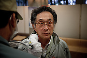 """Koriyama, April 25 2011 - .(eng)  Muramabu Keiji, 59, come to have his radioactivity level checked in a center available 24 hours a day for residents. His compagny asked him to be checked after a day spent in Minami-Soma, 25km from the plant. Refugees can prove with the certificate emitted by the officials that they were not overexposed to radations. The fear of the """"hibakusha"""", Hiroshima's surviving victims, reappears after Fukushima's nuclear accident...(fr) Muramabu Keiji, 59 ans viennent faire controller son niveau de radioactivite dans un centre mis a disposition des habitants 24h/24. Son entreprise lui a demande ce controle apres une journee passe a MinamiSoma, a 25km de la centrale. Les certificats emis par le centre permettent a certains refugies de Fukushima de prouver qu'ils ne sont pas irradies. La peur des """"hibakusha"""", les irradies d'Hiroshima rejetes par la societe, est reapparue."""