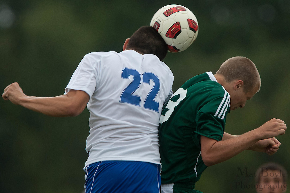 Sterling's Christian Shinkowitz wins a head-ball over West Deptford's Kyle Redrow during the first match of the season at Sterling High School on Thursday September 8, 2011.