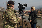 Image shows Major Wendy Faux, Media Operations Group filming a BFBS reporter on Zenica - an area heavily flooded by by the River Bosna in 2014.<br /> <br /> 16/03.2014<br /> <br /> Credit should read: Cpl Mark Larner, Media Ops Group.<br /> <br /> Exercise Civil Bridge is an exercise in support of UK Defence Engagement by elements of 77 Brigade. Civil Bridge 14B (CB14B) is being conducted Sarajevo, Bosnia &amp; Herzegovina (BiH).<br /> <br /> By assisting the BiH Government to develop their contingency plans for natural disasters at both strategic and operational levels, CB14B will contribute to the long term international effort to stabilise BiH ethnic groups and authorities.