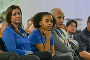 Chrstine, the girlfriend of Mick Cronin (left) and Cronin's 12-year old daughter Samantha Cronin (center) and father Hep Cronin watch as Mick Cronin (not pictured) introduced as the UCLA Bruins new head basketball coach at a news conference on the campus in Los Angeles Wednesday, April 10, 2019. Cronin was hired as UCLA's basketball coach Tuesday, ending a bumpy, months-long search to find a replacement for the fired Steve Alford. The university said Cronin agreed to a $24 million, six-year deal. (Dylan Stewart/Image of Sport)
