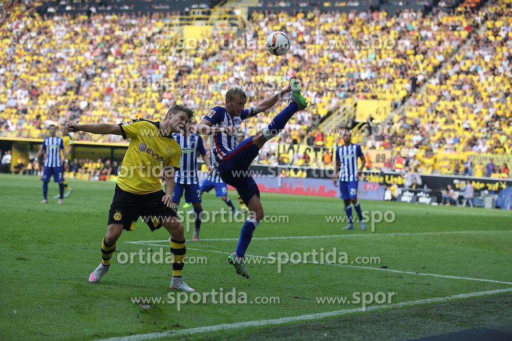 30.08.2015, Signal Iduna Park, Dortmund, GER, 1. FBL, Borussia Dortmund vs Hertha BSC, 3. Runde, im Bild Kapitaen Fabian Lustenberger (Hertha BSC Berlin #28) klaert vor Lukasz Piszczek (Borussia Dortmund #26) // during the German Bundesliga 3rd round match between Borussia Dortmund and Hertha BSC at the Signal Iduna Park in Dortmund, Germany on 2015/08/30. EXPA Pictures &copy; 2015, PhotoCredit: EXPA/ Eibner-Pressefoto/ Schueler<br /> <br /> *****ATTENTION - OUT of GER*****