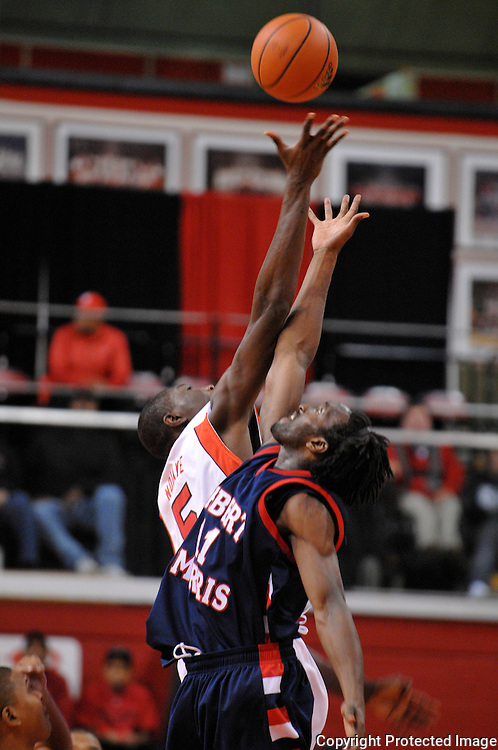 Nov 21, 2008; Piscataway, NJ, USA; Rutgers center Hamady N'Diaye (5) wins the tip off from Robert Morris forward Ifeanyi Ehirim (11) to start Rutgers' 69-55 victory over Robert Morris at the Louis Brown Rutgers Athletic Center.