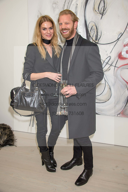 BARBORA BEDIOVA and ALISTAIR GUY at the opening of the exhibition Champagne Life in celebration of 30 years of The Saatchi Gallery, held on 12th January 2016 at The Saatchi Gallery, Duke Of York's HQ, King's Rd, London.