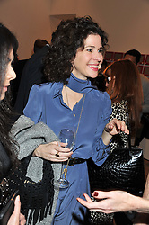 MOLLIE DENT-BROCKLEHURST at the launch of the Krug Happiness Exhibition at The Royal Academy, 6 Burlington Gardens, London on 12th December 2011.