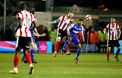 Alan Power of Lincoln City beats Grant Ward of Ipswich Town to a header - Mandatory by-line: Robbie Stephenson/JMP - 17/01/2017 - FOOTBALL - Sincil Bank Stadium - Lincoln, England - Lincoln City v Ipswich Town - Emirates FA Cup third round replay