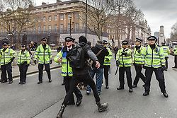 An anti-fascist attempts to break through a police cordon at a Pegida (Patriotic Europeans Against the Islamisation of the West) rally in Whitehall, London UK Feb 2016