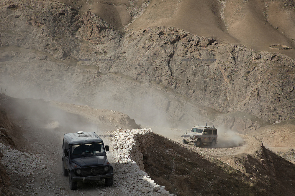 "A joint patrol of german military police and civil german police in the Marmal mountain range near Mazar-e Sharif. These ""show of forces"" patrols are part of the ""Focused District Development""-Programm which metors afghan police."