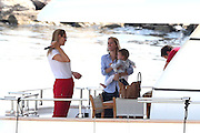 15.JULY.2013. SAINT JEAN CAP FERRAT<br /> <br /> UMA THURMAN AND HER HUSBAND ARPAD BUSSON AND THEIR DAUGHTER LUNA, ON THEIR RENTAL BOAT IN THE PORT OF SAINT JEAN CAP FERRAT.<br /> <br /> BYLINE: EDBIMAGEARCHIVE.CO.UK<br /> <br /> *THIS IMAGE IS STRICTLY FOR UK NEWSPAPERS AND MAGAZINES ONLY*<br /> *FOR WORLD WIDE SALES AND WEB USE PLEASE CONTACT EDBIMAGEARCHIVE - 0208 954 5968*