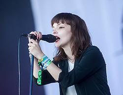 Lauren Mayberry of Chvrches, play on the Radio 1 stage for their third gig at T in the Park 2014.<br /> © Michael Schofield.