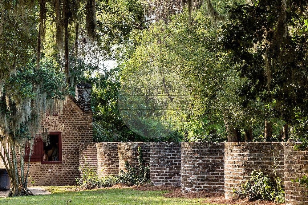 A civil war era slave cabin and barrel wall at Boone Hall Plantation in Mt Pleasant, South Carolina.