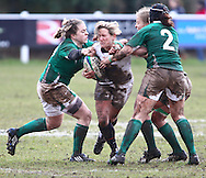 Esher, Surrey, Sunday February 28th 2010: England's Fiona Peacock (white) is tackled by Chris Fanning (2) of Ireland during the Ladies Six Nations match between England and Ireland at Esher Rugby Club. (Pic by Andrew Tobin/Focus Images)