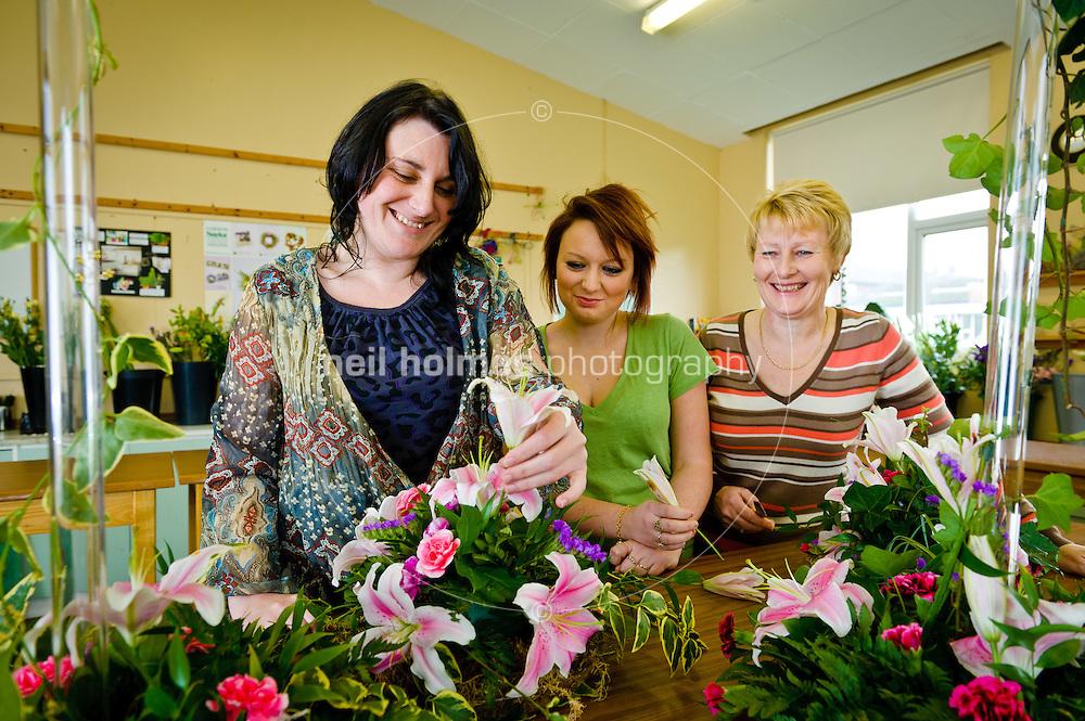 Students at Bishop Burton College, East Yorkshire. creating flower arrangements in the Floristry Studio, pictured LtoR students Kirstie Lythe, Janine Richardson and tutor Beverley Bradshaw.