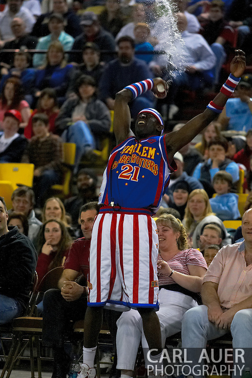 "05 May 2006: Kevin ""Special K"" Daley throws water on the fans during the Harlem Globetrotters vs the New York Nationals at the Sulivan Arena in Anchorage Alaska during their 80th Anniversary World Tour."