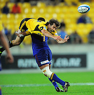 Hurricanes centre Conrad Smith loses the ball in the tackle of Alando Soakai. Super 15 rugby match - Hurricanes v Highlanders at Westpac Stadium, Wellington, New Zealand on Friday, 18 February 2011. Photo: Dave Lintott/PHOTOSPORT