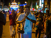 04 OCTOBER 2014 - GEORGE TOWN, PENANG, MALAYSIA: Hindu Musicians perform in George Town during the Navratri procession. Navratri is a festival dedicated to the worship of the Hindu deity Durga, the most popular incarnation of Devi and one of the main forms of the Goddess Shakti in the Hindu pantheon. The word Navaratri means 'nine nights' in Sanskrit, nava meaning nine and ratri meaning nights. During these nine nights and ten days, nine forms of Shakti/Devi are worshiped.   PHOTO BY JACK KURTZ