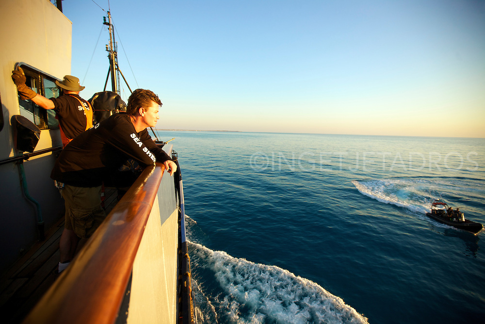 Manager and 2d Officer Beck Straussner from Hawaii is watching one of Seashepherds inflatable boats passing by while Marc 'The whale welder' is repairing a window on the bridge.