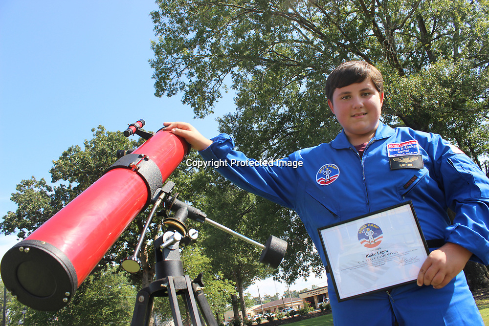RAY VAN DUSEN/BUY AT PHOTOS.MONROECOUNTYJOURNAL.COM<br /> Smithville seventh-grader Blake Ligon stands beside a telescope his great-uncle once owned. Ligon attended Space Camp during his summer vacation.