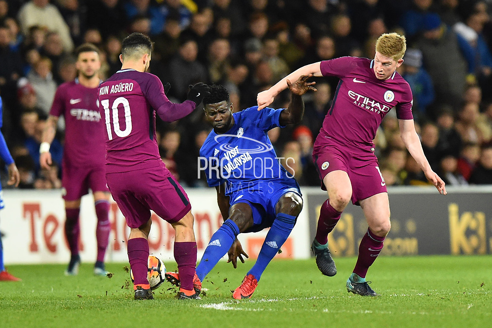 Bruno Ecuele (5) of Cardiff City makes a bad tackle on Sergio Aguero (10) of Manchester City during the The FA Cup 4th round match between Cardiff City and Manchester City at the Cardiff City Stadium, Cardiff, Wales on 28 January 2018. Photo by Graham Hunt.