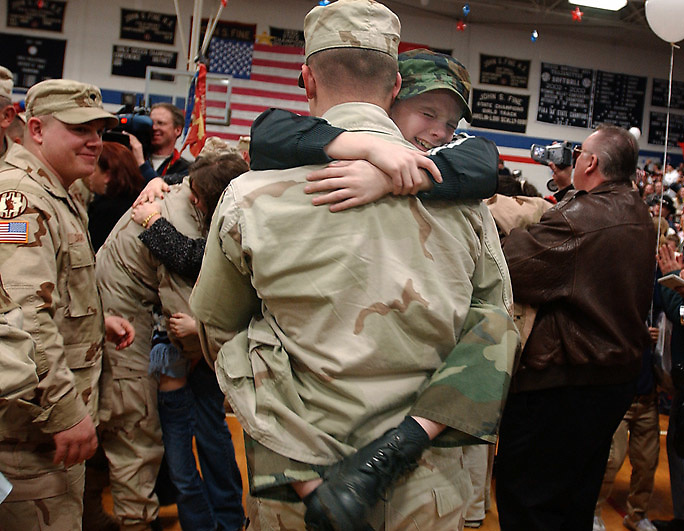 SPC Brian Martin breaks from formation to a great hug from his son after the 109 Bravo battery returned home to a celebration at the Nanticoke High School.   Aimee Dilger/Photo Times Leader NEWS