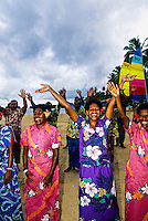Staff members wishing farewells to departing guests, Nukubati Island Resort, Fiji Islands