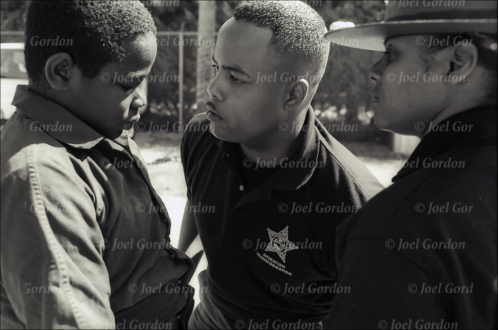 African American drill instructor hazing recuit at the Saturday Boot Camp for first-time offenders, Operation Transformation, an early intervention progam, juveniles are between the ages 10 to 15, Orange County Sheriff's Office in Orlando FL.
