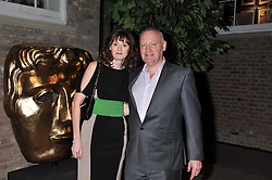 BAFTA chief executive AMANDA BERRY and ALISTAIR DIXON at the Asprey BAFTA Party held at Asprey, 167 New Bond Street, London on 11th February 2012.