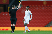 Leeds United Henri Kumwenda (9) is booked and receives a caution and a yellow card  during the FA Youth Cup match between U18 Manchester United and U18 Leeds United at Old Trafford, Manchester, England on 5 February 2020.