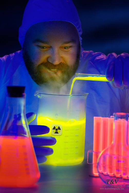 Mad scientist mixing glowing fluid with test tubes and beakers.Black light