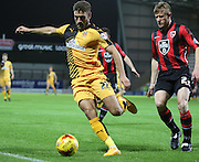 Andy Parrish and Ben Williamson during the Sky Bet League 2 match between Morecambe and Cambridge United at the Globe Arena, Morecambe, England on 24 November 2015. Photo by Pete Burns.