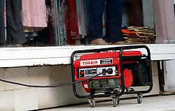 PRISTINA, KOSOVO - DECEMBER 14 -  zaradi redukcij srbske elektrike so razsirjeni agregati, generatorji elektrike, posebno pred trgovinami, kjer niti niso prizgane luci