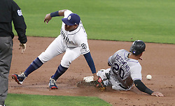 May 2, 2017 - San Diego, CA, USA - The throw to the San Diego Padres' Yangervis Solarte, left, by catcher Austin Hedges gets past him as the Colorado Rockies' Ian Desmond (20) steals second base in the second inning at Petco Park in San Diego on Tuesday, May 2, 2017. (Credit Image: © Hayne Palmour Iv/TNS via ZUMA Wire)