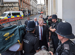 © Licensed to London News Pictures. 08/08/2018. Bristol, UK. England cricketer BEN STOKES arrives at Bristol Crown court today past media and police for the third day of his trial on charges of affray that relate to a fight outside a Bristol nightclub on September 25 2017. Stokes and two other men, Ryan Ali, 28, and Ryan Hale, 27, all deny the charge. Stokes, Ali and Hale are jointly charged with affray in the Clifton Triangle area of Bristol on September 25 last year, several hours after England had played a one-day international against the West Indies in the city. A 27-year-old man allegedly suffered a fractured eye socket in the incident. Photo credit: Simon Chapman/LNP