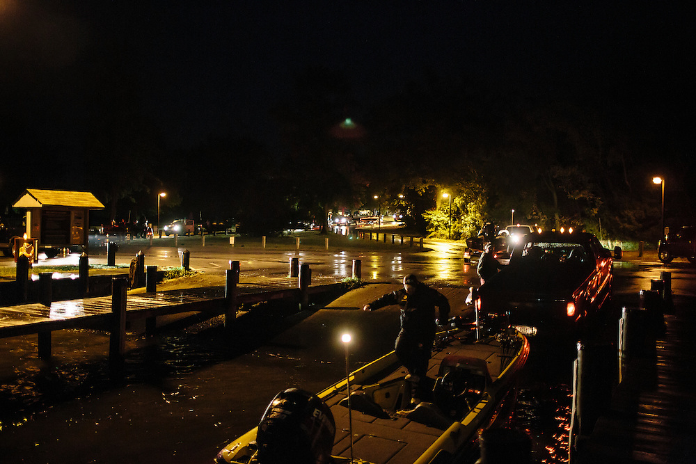 Teams drop their boats in the water before sunrise during the FLW College Fishing Northern Conference Invitational in Marbury, MD on Oct. 11, 2014. Only the top 15 of 43 teams moved on to Sunday.